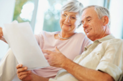 Image of a mature couple reading estate documents